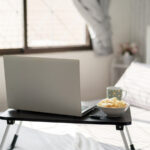 work-home-bed-table-laptop_istock